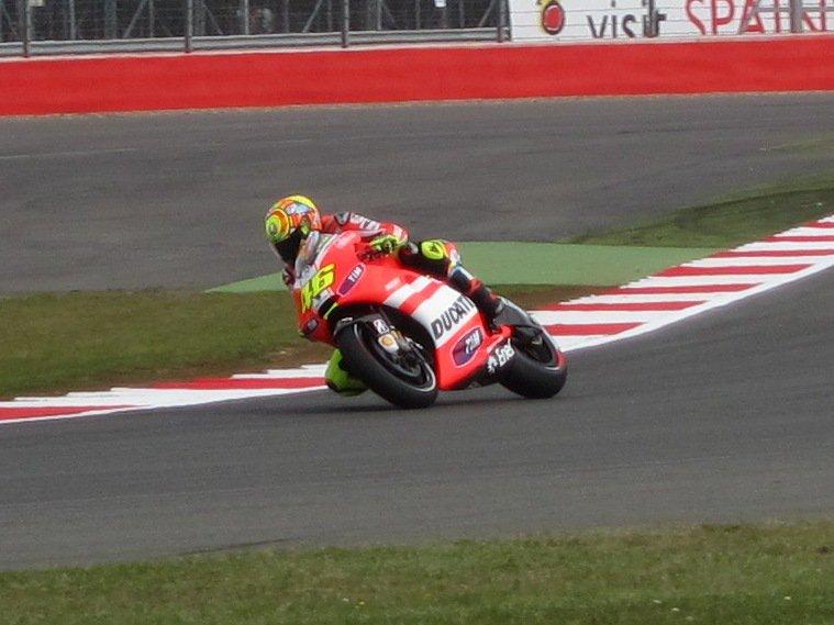 9-time world champion Valentino Rossi wrestles his Ducati around Silverstone