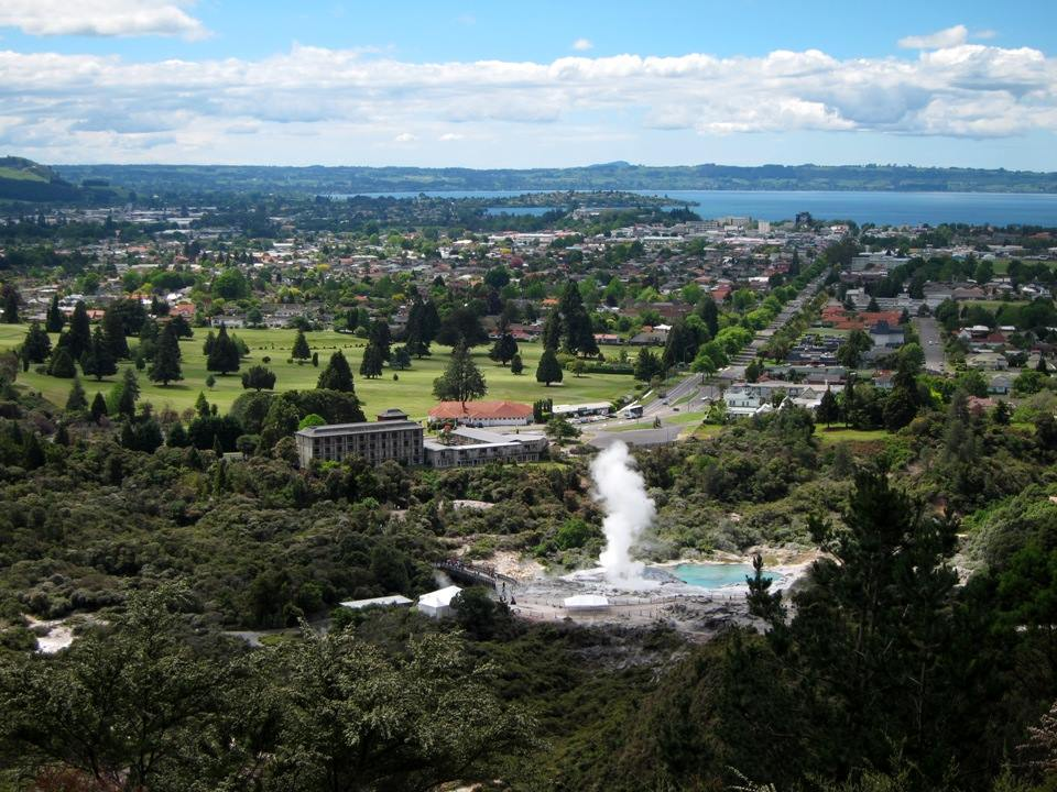Pouhutu Geyser with Rotorua in the background